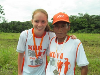 Sierra at a 5k race with the second-place finisher, an indigenous Kichwa woman who ran barefoot