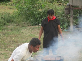 Carlos and Alex help prepare the tapir meat