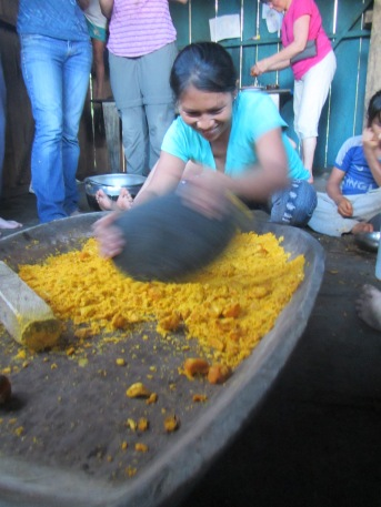 Ceci's sister, Lourdes, shows us how to mash the chonta fruit to make a drink called chicha