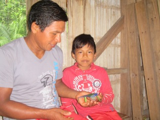 Manuel shows his turtle to his father (and one of our cooks), Alfonso