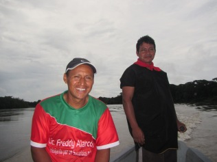 Two of our guides, Oswaldo and Alex (driving the motorized canoe)