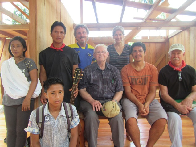 Gathered in the home that Iter is building for us -- from left: Irene, Iter, Charles (their son, seated before them), Jerrell, Vance, Jane, Felipe (grandson of the first missionaries) and Randy (Felipe's father)