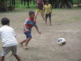 The children of the village enjoy soccer